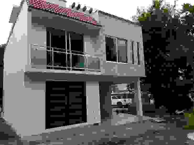 CASA X001 Casas modernas de erram arquitectos Moderno Piedra