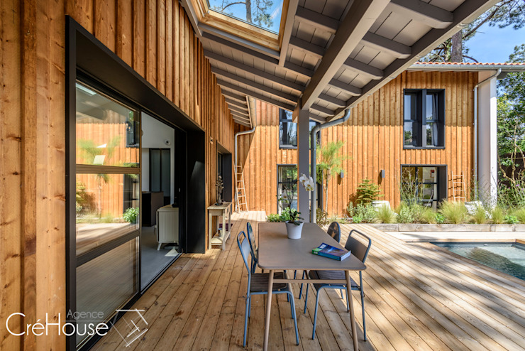 Houses by Agence CréHouse, Modern