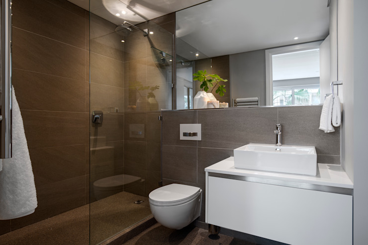 WATERFRON STAY_GULMARN APARTMENTS:  Bathroom by MINC DESIGN STUDIO