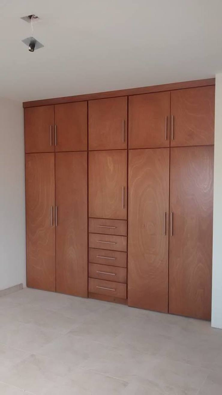DLR ARQUITECTURA/ DLR DISEÑO EN MADERA Dressing roomStorage Wood Wood effect