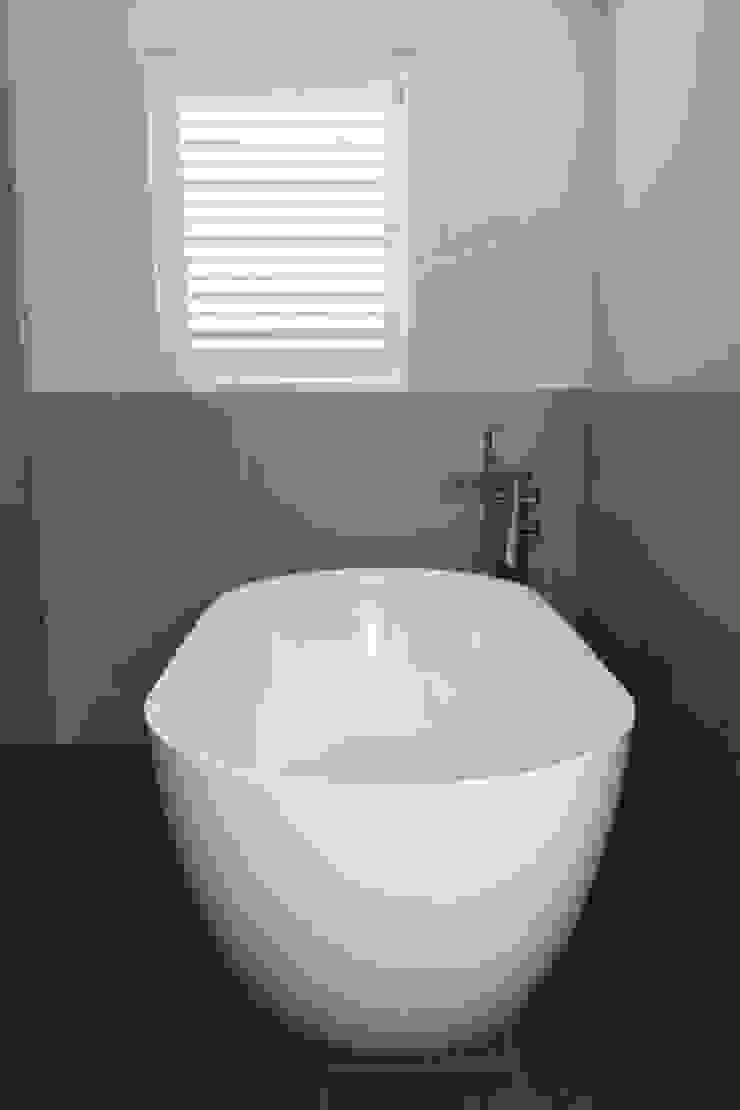 Bathroom Shutters For Sash Windows: modern  by Plantation Shutters Ltd, Modern Wood Wood effect
