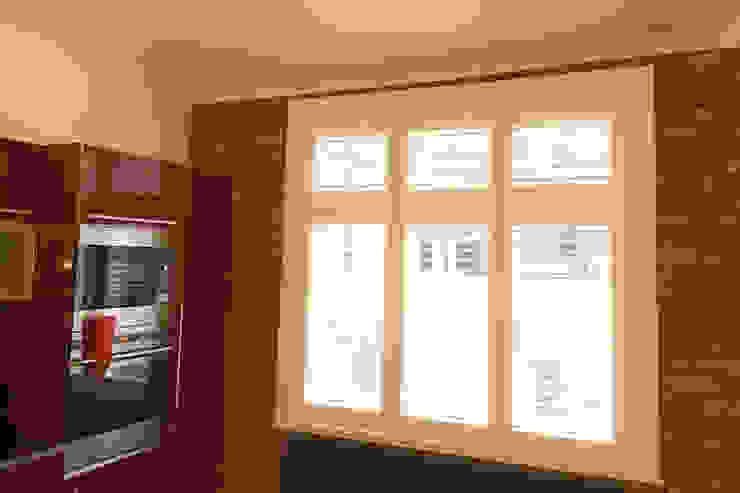 Kitchen Shutters For Sash Windows: modern  by Plantation Shutters Ltd, Modern Wood Wood effect