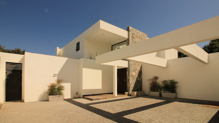 Casa B Casas de estilo mediterráneo de Carvallo & Asociados Arquitectos Mediterráneo