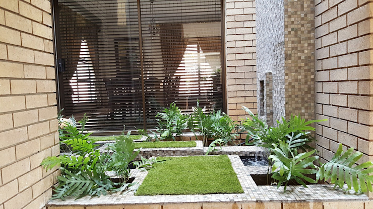 New driveway for Nkateko and Liesel:  Garden by Gorgeous Gardens,