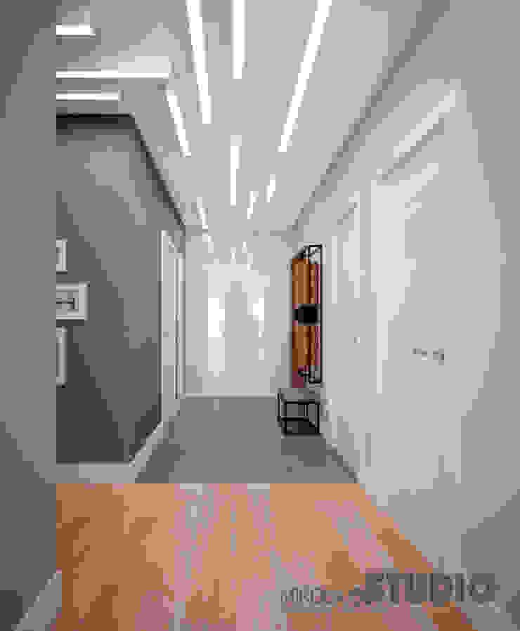Modern corridor, hallway & stairs by MIKOŁAJSKAstudio Modern
