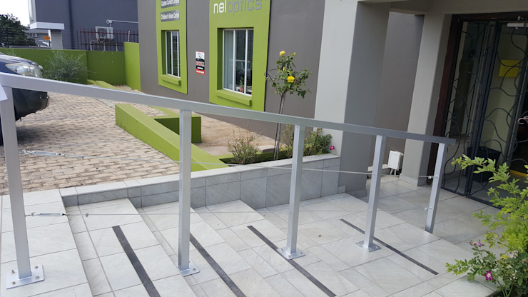 Design and installation of rails for business by SOJE Interior, Design and Decor PTY (Ltd) Industrial Metal