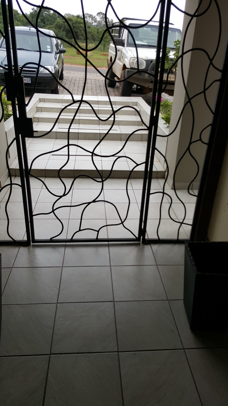Steel gate at business by SOJE Interior, Design and Decor PTY (Ltd) Industrial Iron/Steel