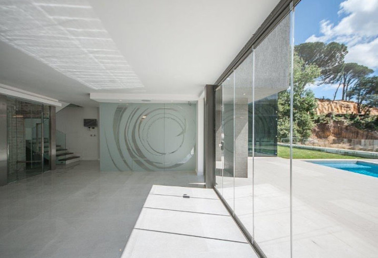 Garden level entertainment space. Modern living room by Architectural Hub Modern