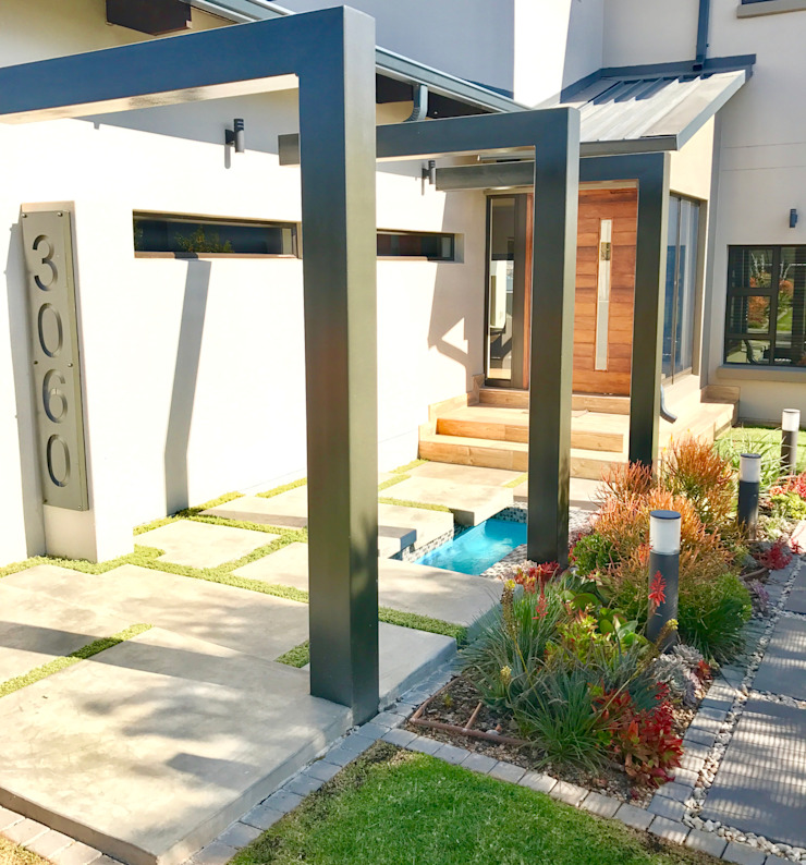 Entrance walkway with pergola Modern Garden by Acton Gardens Modern Metal