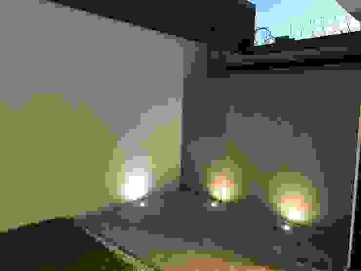 Jardins modernos por Alfagrama estudio Moderno Pedra Calcária