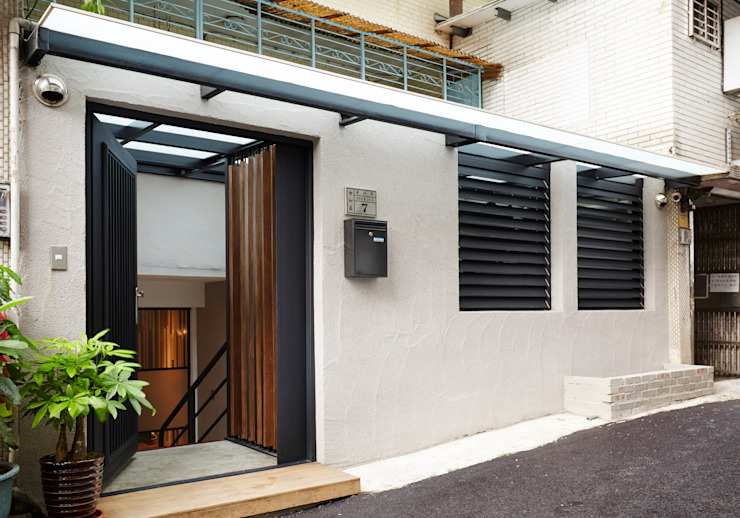 Casas de estilo  de 弘悅國際室內裝修有限公司,