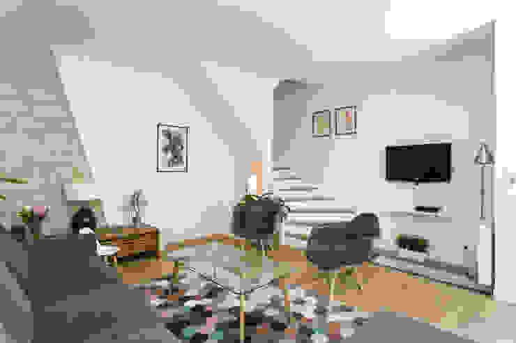 Elévation et rénovation d'une maison de ville à Clichy: Salon de style  par Mon Concept Habitation, Moderne