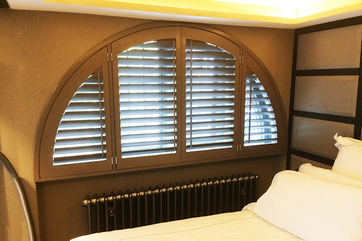Special Shape Shutters in The Bedroom: modern  by Plantation Shutters Ltd, Modern Wood Wood effect
