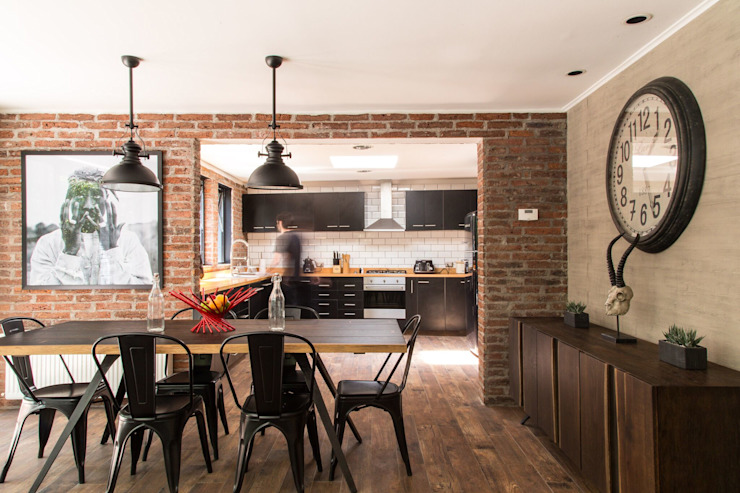 Dining room by RENOarq, Modern Bricks