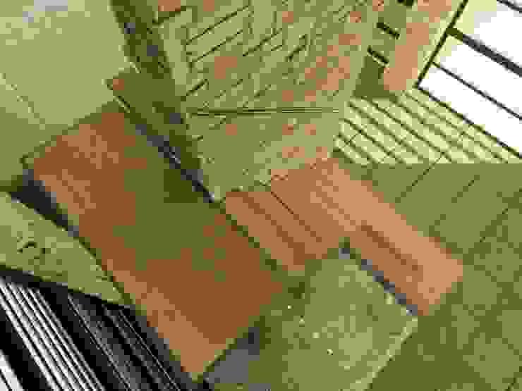 CASAS CASTRO PERAFAN Elite Arquitectura y Asoc. SAS. Casas modernas Ladrillos Marrón