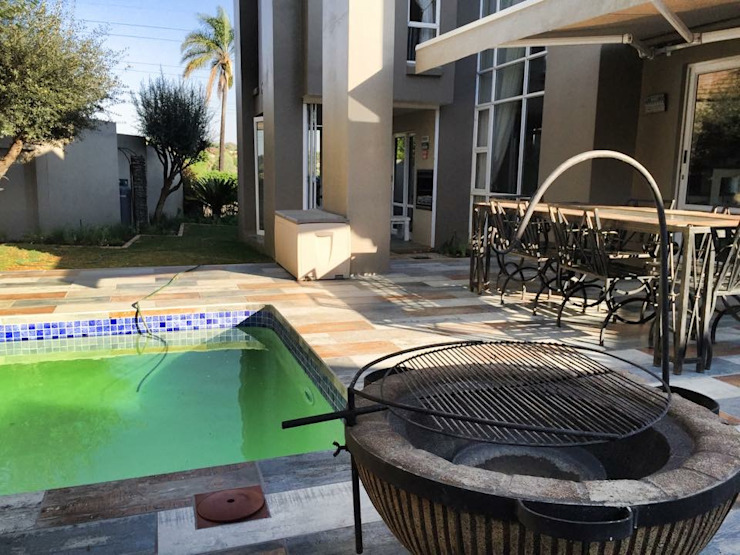 New Pool and Patio - view from the fire pit:  Patios by Acton Gardens,