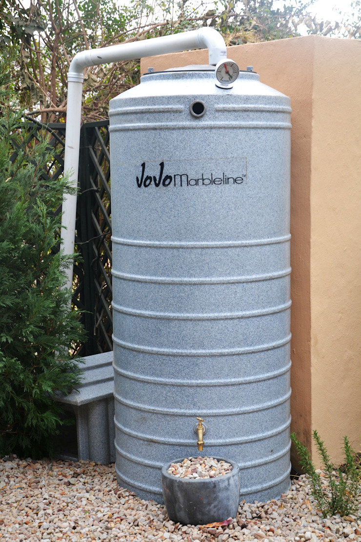 Rain Harvesting tank Industrial style gardens by Acton Gardens Industrial Plastic