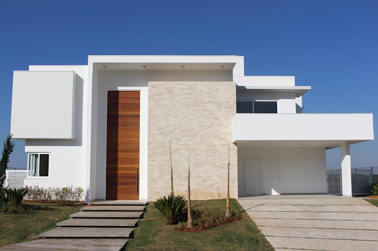 Residência Condomínio Fazenda SerrAzul _ AS: Casas  por Araujo Moraes Engenharia Arquitetura,Moderno Pedra