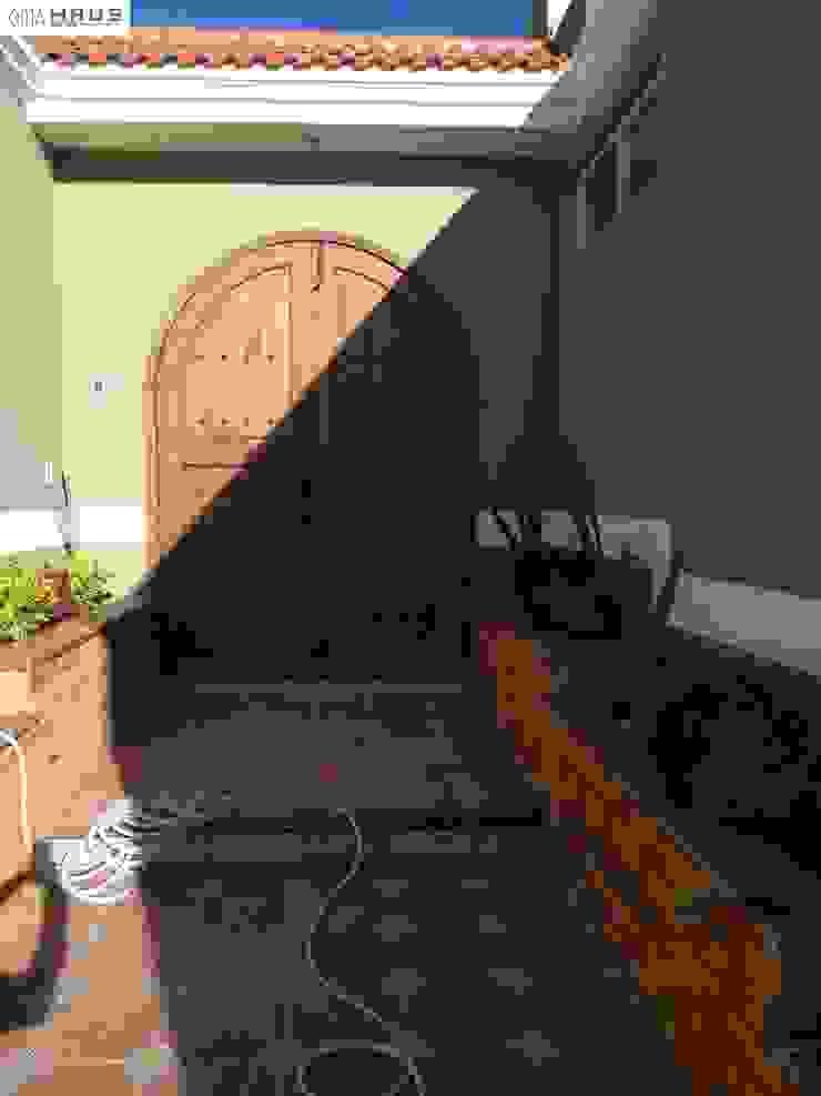Acceso Principal OmaHaus Arquitectos Casas rústicas