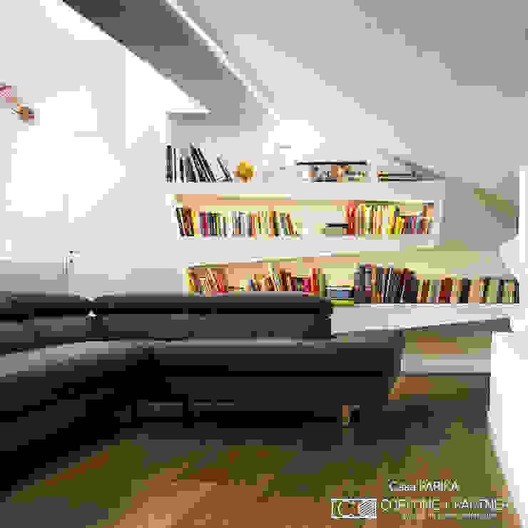 CASA PARIKA: Soggiorno in stile  di CORFONE + PARTNERS studios for urban architecture