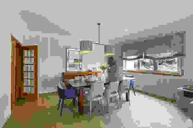 Sala e Varanda em Paço de Arcos Sizz Design Salas de jantar tropicais