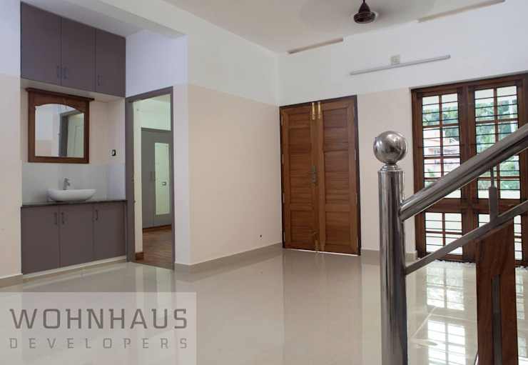 1400sqft House in Trivandrum Modern corridor, hallway & stairs by Wohnhaus Developers Modern Ceramic