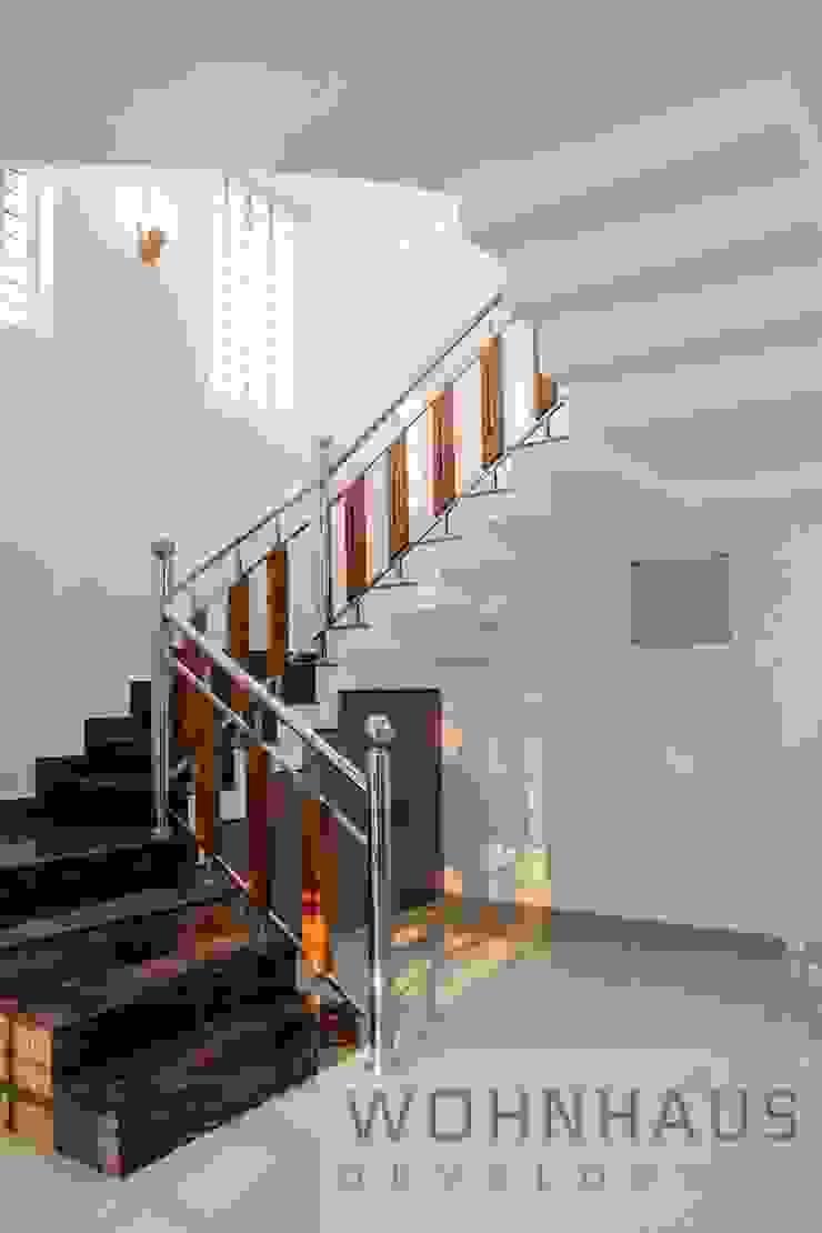 1400sqft House in Trivandrum Modern corridor, hallway & stairs by Wohnhaus Developers Modern Iron/Steel