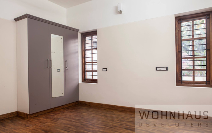 1400sqft House in Trivandrum Modern style bedroom by Wohnhaus Developers Modern Wood Wood effect