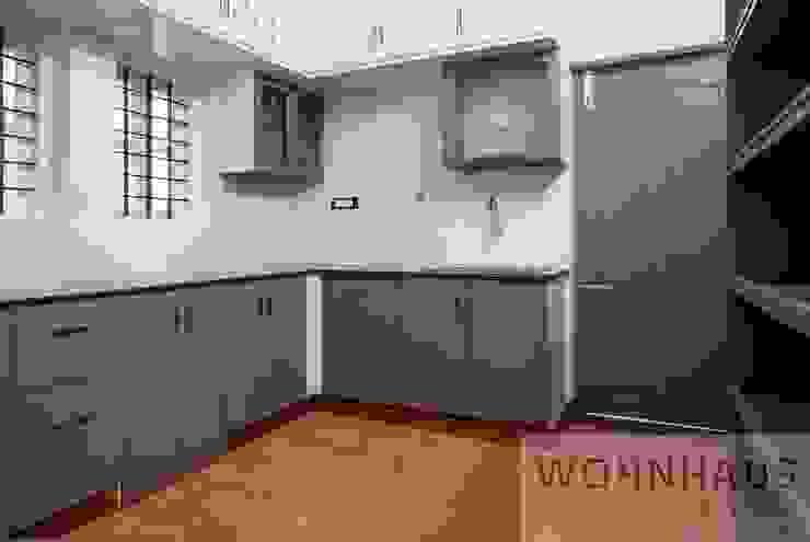 1400sqft House in Trivandrum Modern kitchen by Wohnhaus Developers Modern Sandstone