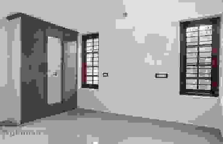 1400sqft House in Trivandrum Modern style bedroom by Wohnhaus Developers Modern Ceramic