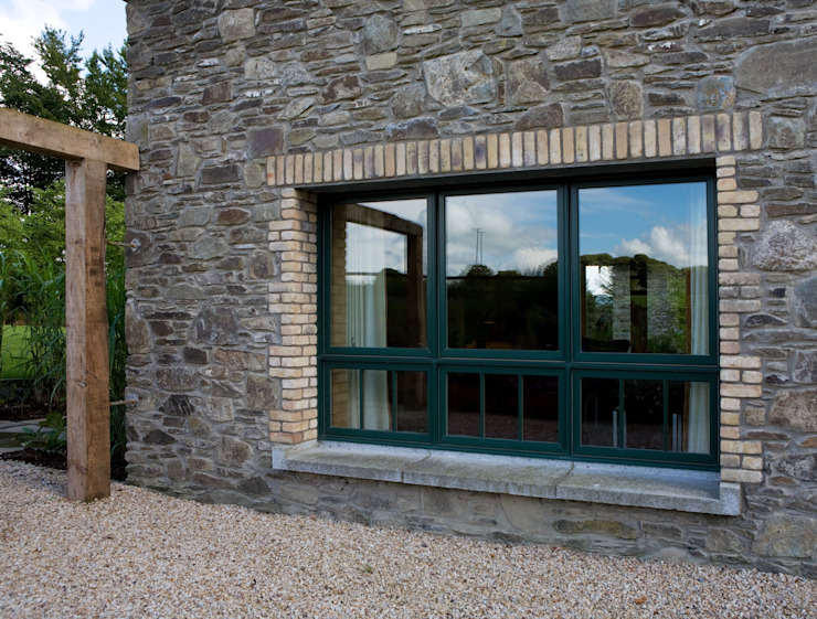 Exterior View Of Marvin's Finely Crafted Aluminium Clad Wood Casement Windows by Marvin Windows and Doors UK Modern