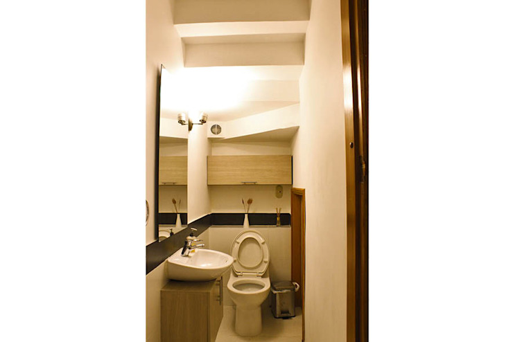 Baños de estilo  por Ensamble de Arquitectura Integral, Minimalista