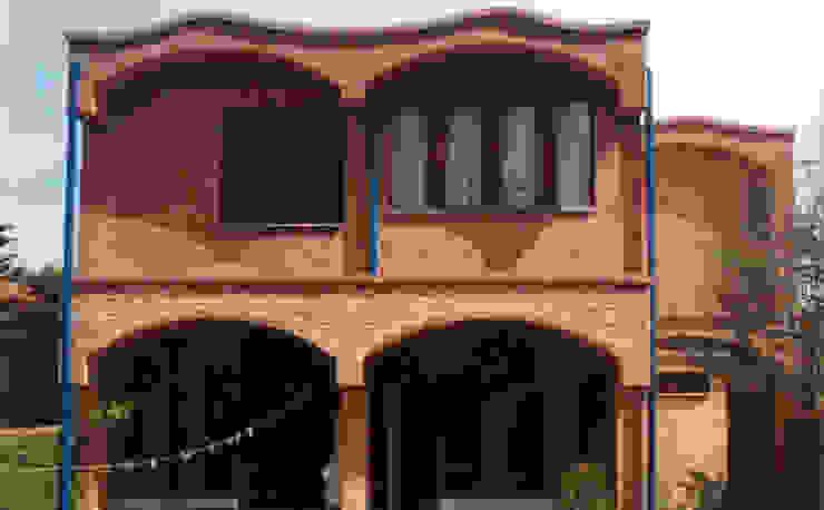Casas unifamiliares de estilo  por JMN arquitetura, Rústico Ladrillos