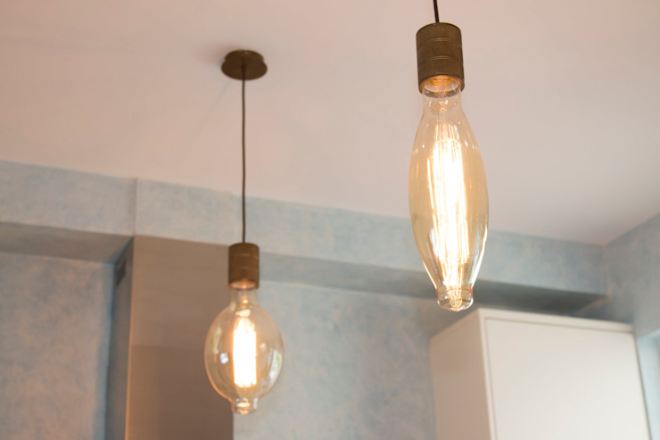 Filament bulbs above the kitchens island add ambience من ADORNAS KITCHENS إنتقائي خشب Wood effect