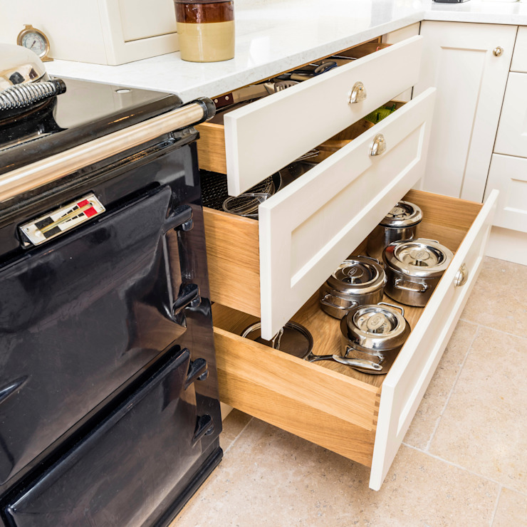 Drawer storage for pans next to Aga cooker by John Gauld Photography Modern