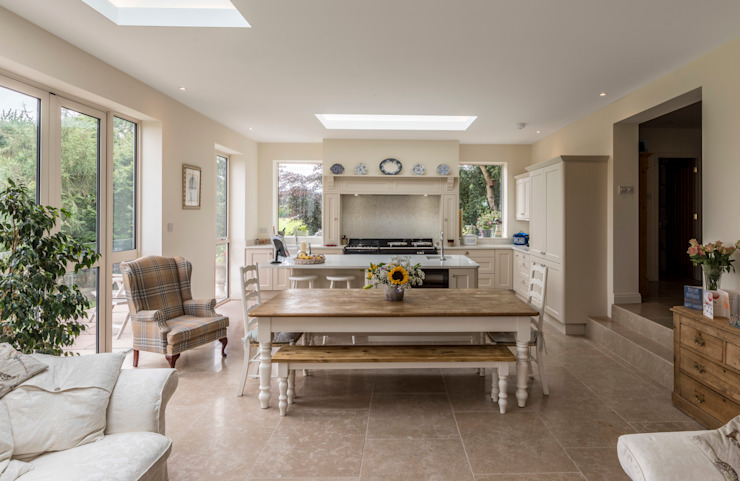 Long view of kitchen and family room Modern living room by John Gauld Photography Modern
