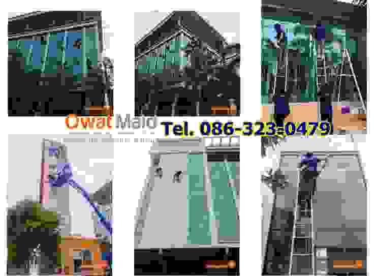 ทำความสะอาดกระจกอาคารที่สูง โดย Owat Pro And Quick Co.,Ltd.