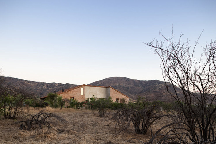 Casa Cuatro Aguas de Dx Arquitectos Rústico