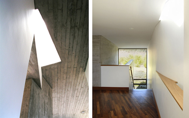 Casa Rabanua: Pasillos y hall de entrada de estilo  por Dx Arquitectos