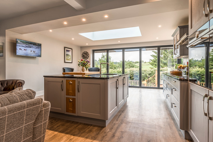 High Peak.  Stunning views of the High Peak countryside from this family room extension:  Kitchen by John Gauld Photography, Modern