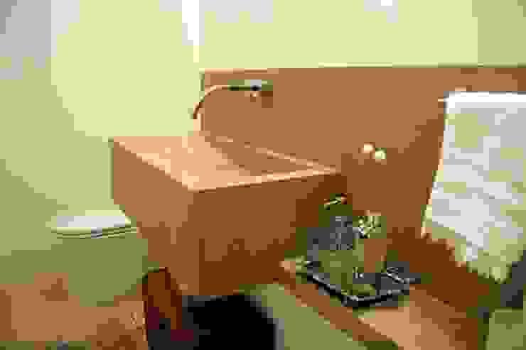 Lavabo com lavatório em porcelanato Moussi Arquitetura Banheiros modernos