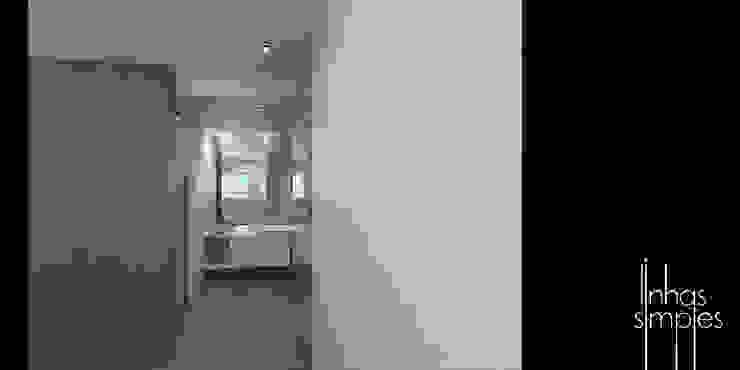 Entre espaço publico e privado... a casa de banho Casas de banho modernas por Linhas Simples Moderno