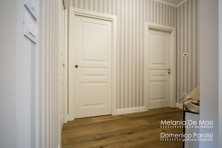 Wooden doors by melania de masi architetto, Classic