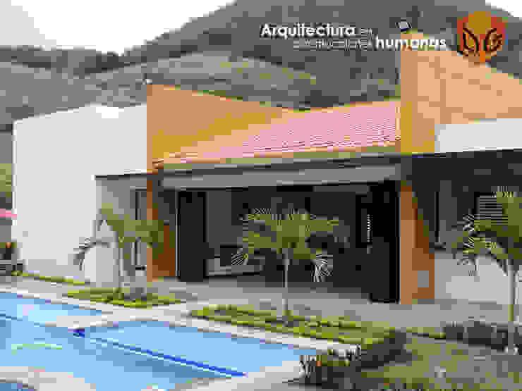 FACHADA PRINCIPAL de DG ARQUITECTURA COLOMBIA Moderno