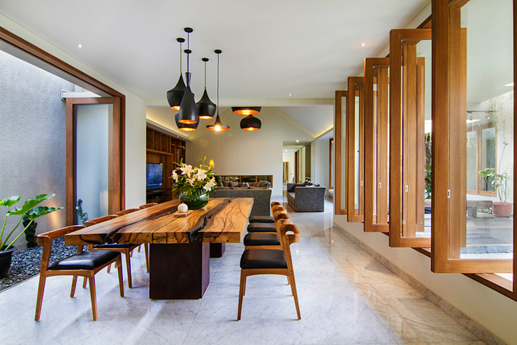 dining room:modern  oleh e.Re studio architects, Modern