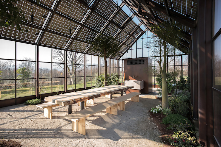 hillside house Country style conservatory by zanon architetti associati Country