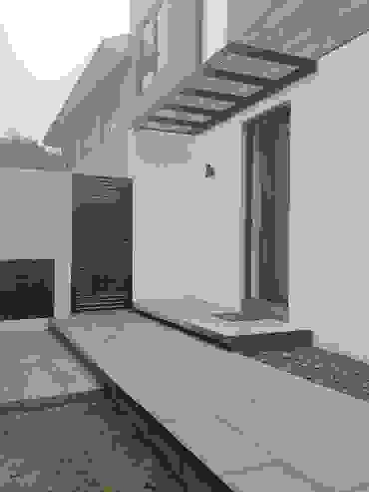 CASA BARTOLOME SHARP Casas de estilo minimalista de [ER+] Arquitectura y Construcción Minimalista