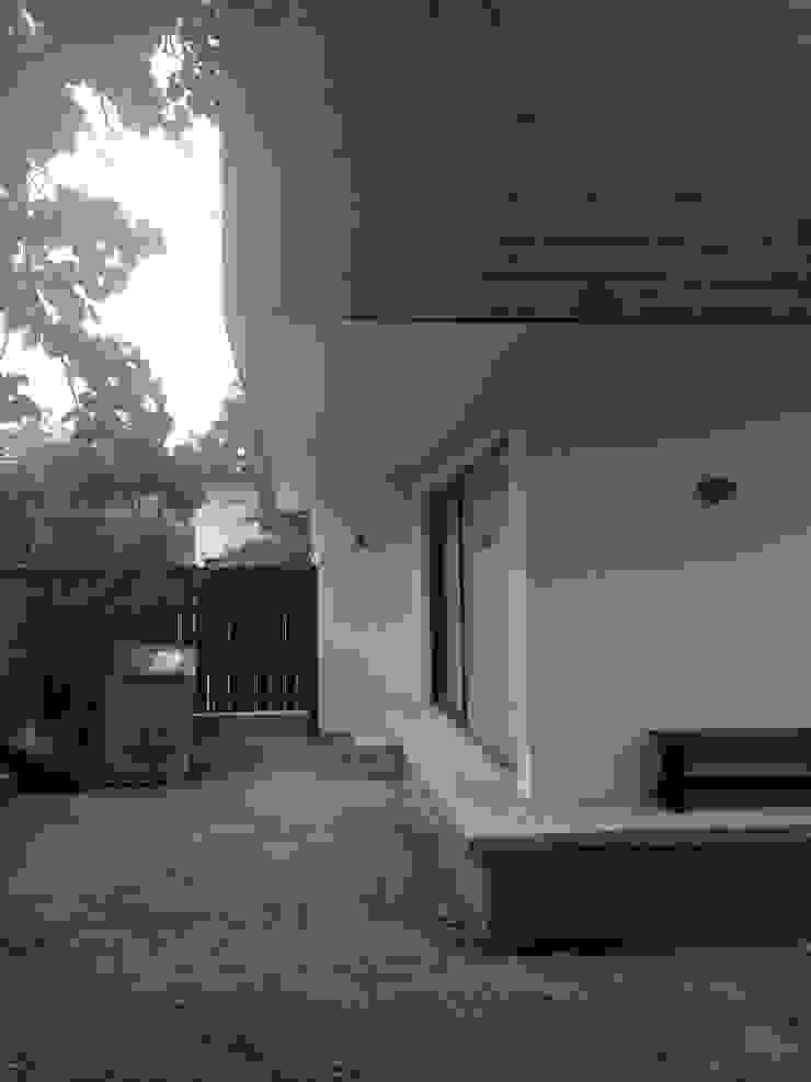 CASA BARTOLOME SHARP [ER+] Arquitectura y Construcción Casas de estilo minimalista