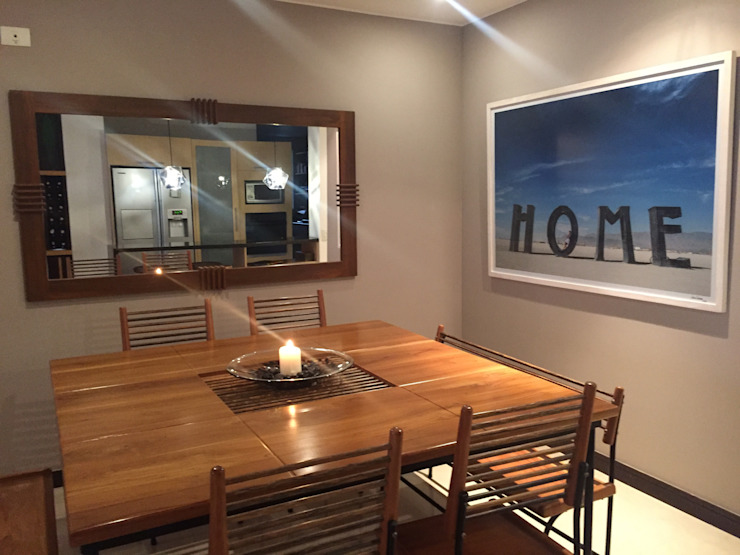 Eclectic style dining room by ANA ESTRADA DISEÑO INTERIOR Eclectic Solid Wood Multicolored