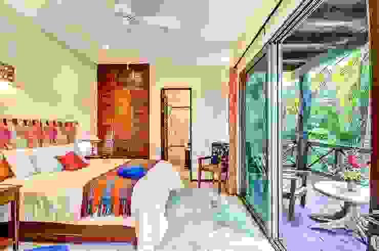 Egzotyczna sypialnia od DHI Arquitectos y Constructores de la Riviera Maya Egzotyczny